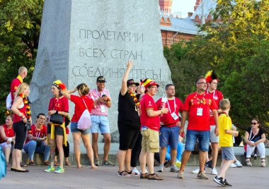 2018.06.17, Moscow, Russia. Belgian fans of football on background of famous monument in Moscow. World cup 2018. People wearing colorful clothes.
