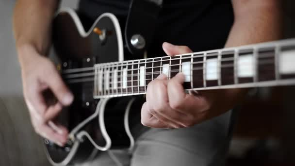 Mans hands playing the funky rhythm on electric guitar, electric musical instruments, playing loud on the guitar, rock guitars