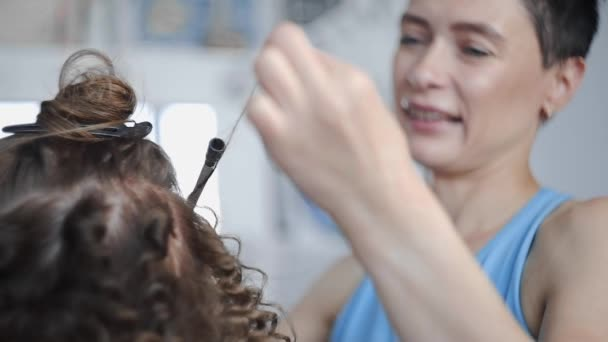 Hairdresser Makes Curly Afro Hairstyle For Woman By Hot Curling Hair