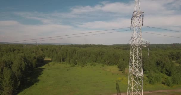 Top view, AERIAL: power lines. Electric high-voltage supports. Transmission of electricity by wire. 4K