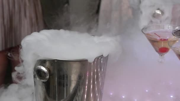 Dry Ice in a pail for ice. Champagne pyramid for parties with cherries. slow motion