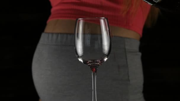 close-up pregnant belly, women drinking red wine. Third trimester. motherhood and alcohol concept. slow motion
