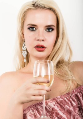 elegant blonde woman holding glass of champagne. celebration concept