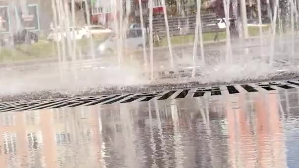 Reflection of houses on a smooth surface of fountain. Beautiful nature of the big city. slow motion