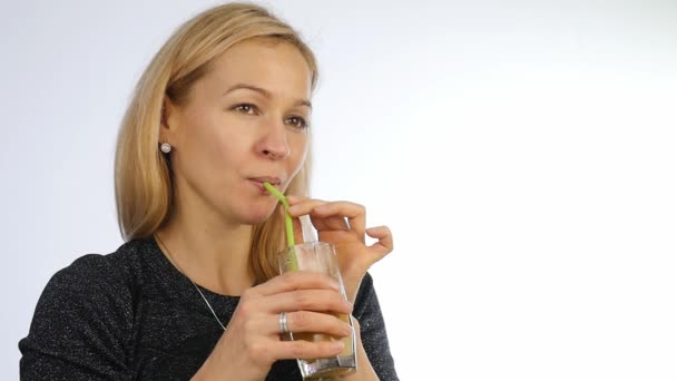blonde woman drinks fruit cocktail, detox smoothie. Fitness and healthy lifestyle concept. slow motion