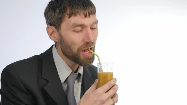 bearded businessman drinks detox smoothie, healthy lifestyle concept. cocktail from vegetable and fruit. slow motion
