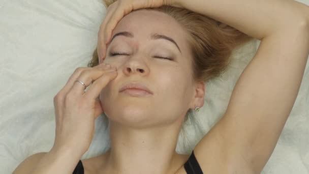 Prevention of skin aging, woman performs exercises for a face building