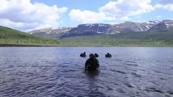 scuba diving in a mountain lake, practicing techniques for emergency rescuers. immersion in cold water