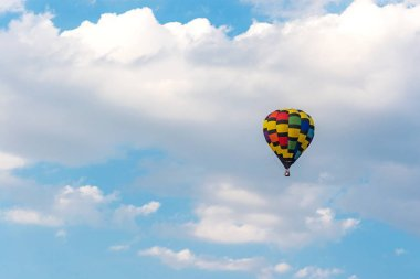 Hot air balloon in the blue sky clouds background to destination leisure travel.  Vacation Nature Concept