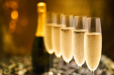 Many glasses of champagne in a line. Selective focus. Vintage tone