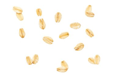 Dry raw oat flakes isolated on white background. Rolled flat grains of wheat, bran, barley, bye cereals for muesli or granola