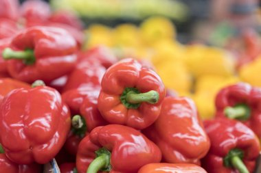 ed pepper on street market shelf. Red bell pepper pattern. Background of fresh sweet heap of red pepper paprica closeup vegetable shop. Red bulgarian paprika harvest pile from organic farm for sale.