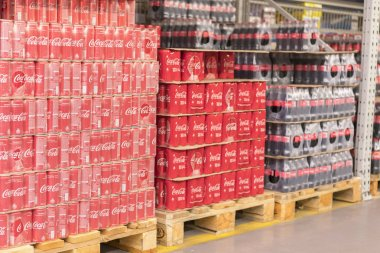 Kiev, Ukraine. August 28 2018. Coke in bottles on row of shelf display for sale in hypermarket grocery store. Coca-Cola, or Coke, is a carbonated soft drink produced by The Coca-Cola Company