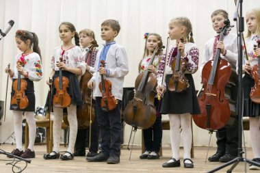 Kiev, Ukraine - January 21, 2019: Children violin ensemble. Children with violins on stage.