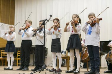 Kiev, Ukraine. January 21 2019 Children's violin ensemble. Children with violins on stage. Children's initiative, small talents. Early child development