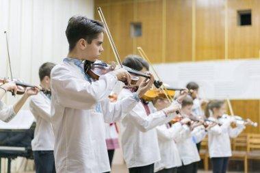 Kiev, Ukraine. January 21 2019 Children's violin ensemble. Children with violins on stage. Children's initiative, small talents. Early child development