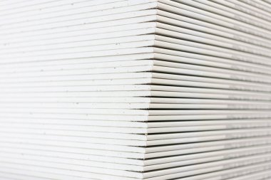 The stack of gypsum boards preparing for construction.