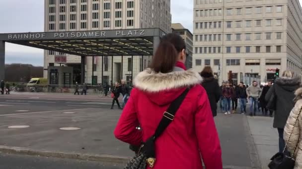 Tourists Cross The Street At Traffic Lights At Potsdamer Platz In Berlin