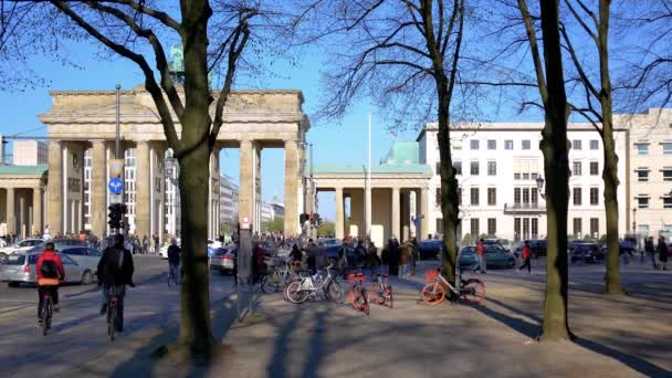 Tourists And Traffic At Brandenburger Tor In Berlin, Germany In Spring