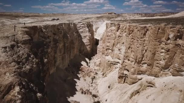 man looks into the distance in the deserts and mountains in Kazakhstan like from another planet