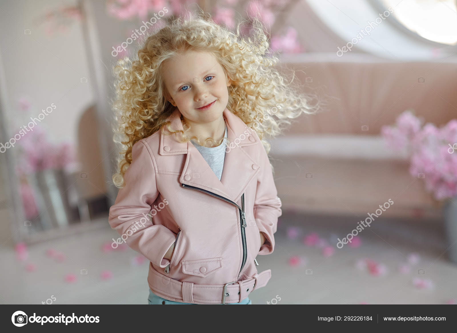 Little Pretty Girl Curly Blonde With Blue Eyes In A Pink Jacket Stock Photo C Coy Creek 292226184