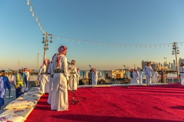 Doha, Qatar, Jan 9th 2018 - Colorful celebration in Doha, with local people dressed with traditional clothes, blue sky day, music instruments and audience in Doha, Qatar.