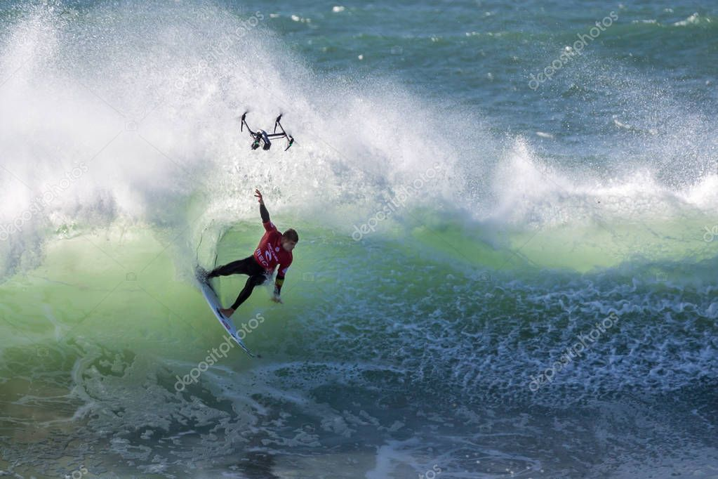 Peniche, Portugal - Oct 25th 2017 - Mick Fanning turning in a wave, drone in the image during the World Surf League's 2017 MEO Rip Curl Pro Portugal surf competition