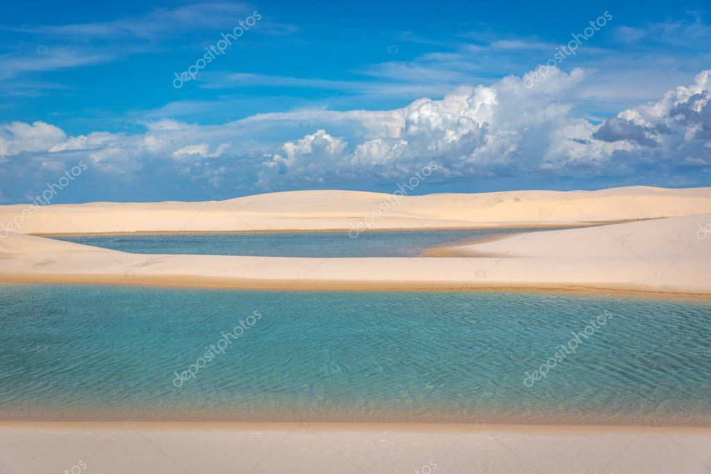 Amazing natural pools through white sand dunes. Exotic holiday destination in north of Brazil