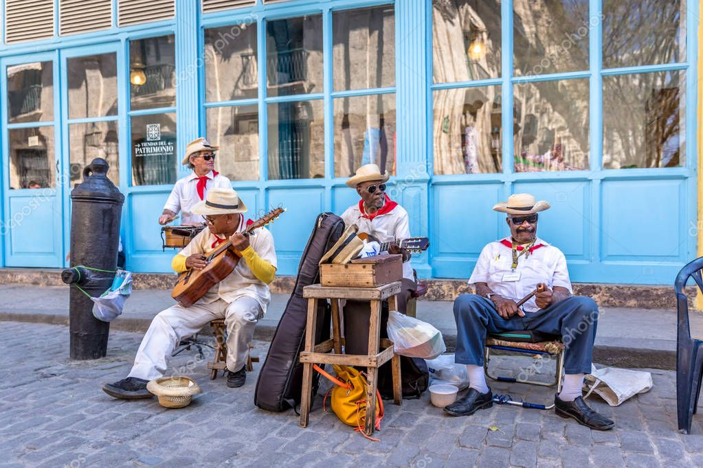 Havana, Cuba - March 11th 2018 - A group of musicians playing at the streets of Havana, Cuba.