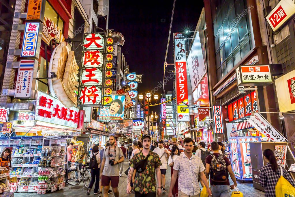 Osaka, Japan - Sep 20th 2018 - Tourists in a busy street in Osaka Downtown, plenty of billboards, colorful scenario, Japan