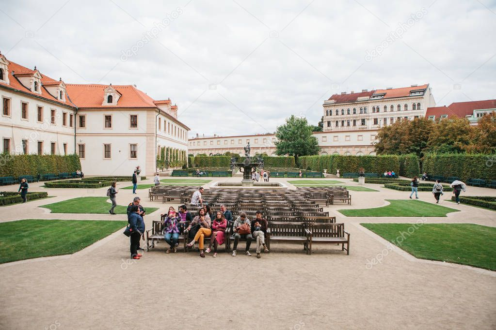 Prague, September 18, 2017: Tourists visit the famous Valdstejn garden in the city. Some of them rest on benches. A popular tourist attraction and a place to relax for the locals