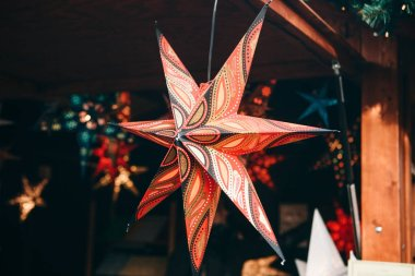 A close-up star is on sale at the Christmas market in Berlin.