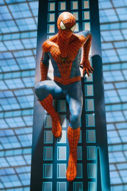 A human-sized figure of the Spiderman character in a toy store Hamleys
