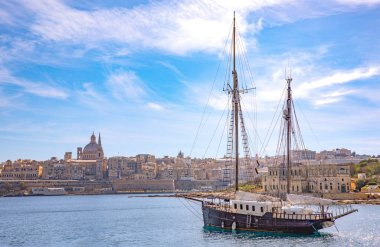 Malta, Valletta, the ancient architectures of the city seen from the sea with  an ancient sailing ship in the foreground