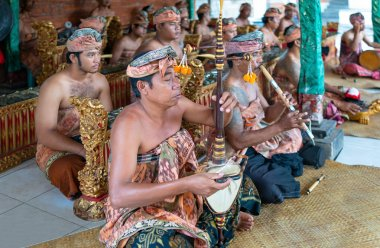 Bali, Indonesia - March 23, 2017:  Players in traditional costume in the Goa Gajah temple