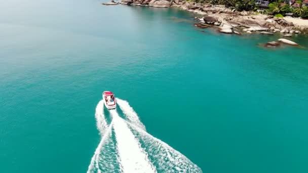 white yacht sailing on blue sea waves