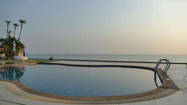luxury swimming pool at sunset, video
