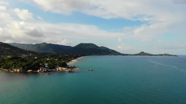 amazing aerial view of sea and tropical island on sunny day