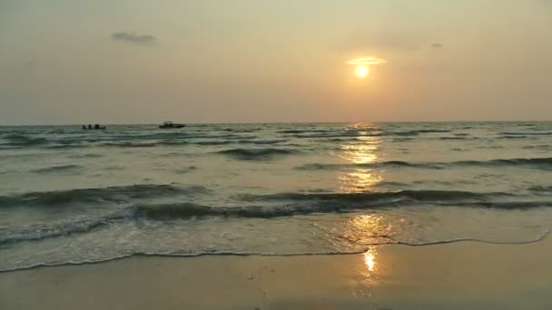 sunset view of sea waves, sandy beach and dramatic sky