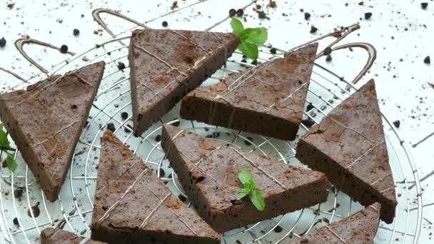 delicious chocolate brownie cakes with mint leaves