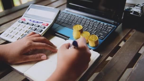 Close up accountant audit using calculator to calculate financials graph analytics data. Accountant hands Trading Information with excel file. Finance statistic report analyze working outdoor desk