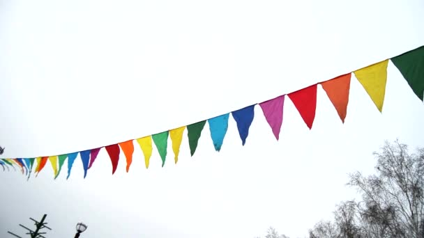Colorful triangular flags waving in the wind, decoration for the holiday, outdoor