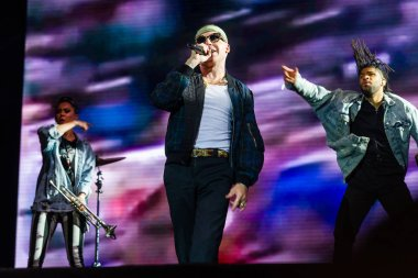 PANENSKY TYNEC, CZECH REPUBLIC - JUNE 30, 2018: American rapper Macklemore (in the middle) during his performance at Aerodrome festival in Panensky Tynec, Czech Republic, June 30, 2018.
