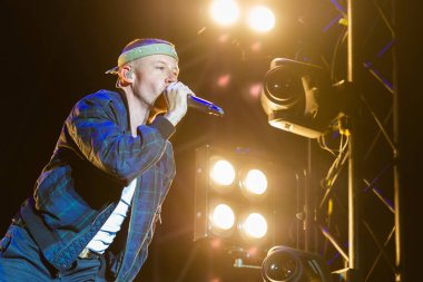 PANENSKY TYNEC, CZECH REPUBLIC - JUNE 30, 2018: American rapper Macklemore during his performance at Aerodrome festival in Panensky Tynec, Czech Republic, June 30, 2018.