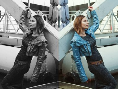 Beautiful girl in a gray dress and a denim jacket leaning on iron beams. Mirror reflection. Color and BW version of the photo. Shooting outdoors, shallow depth of field