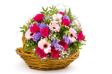 colourful flowers in basket isolated on white background