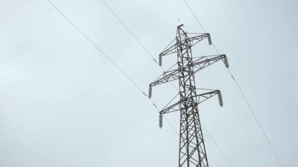 Electricity pylon on a cloudy sky
