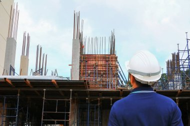 architect engineer check workflow construction in building site