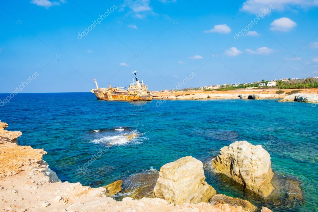 Abandoned rusty ship wreck EDRO III in Pegeia, Paphos, Cyprus. It is stranded on Peyia rocks at kantarkastoi sea caves, Coral Bay, Pafos, standing at an angle near the shore.