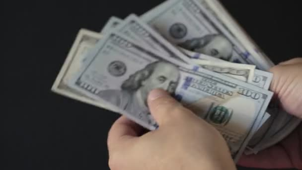 Close Up Male Hands Count Hundred Dollar Bills in the Dark